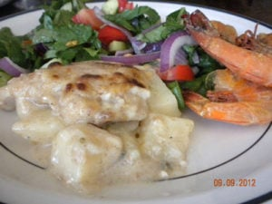 Baked fish fillet with béchamel sauce