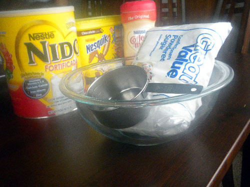 A photo showing several products, a glass bowl and sugar