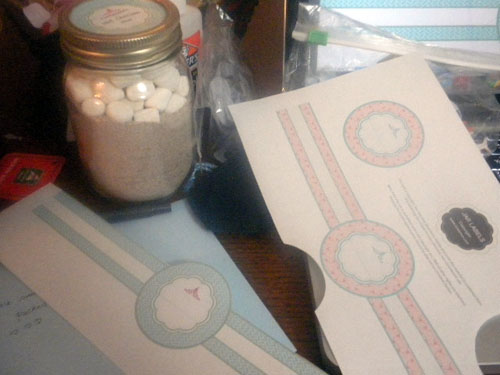 A close up of jar with Marshmallow and a box