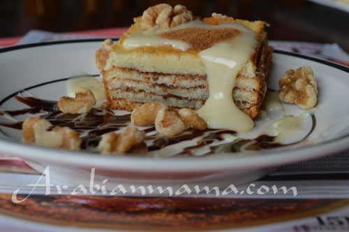 A close up of Cinnamon layered cake on a plate