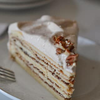 A piece of cinnamon cake on a plate