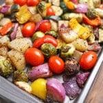 roasted vegetables on a baking sheet.