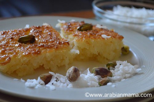 A close up of Bassema dessert on a white plate with nuts
