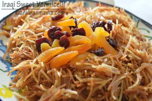 A dish is filled with vermicelli, dried fruits and nuts