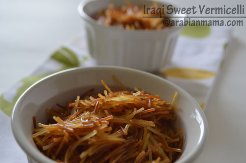 A bowl of food on a table, with Vermicelli