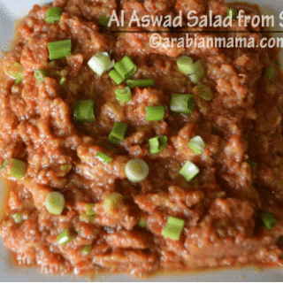 A plate of food with Al Aswad salad
