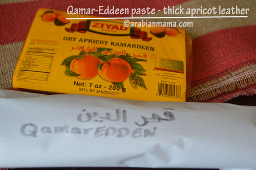 A close up of a piece of dried apricot paste product