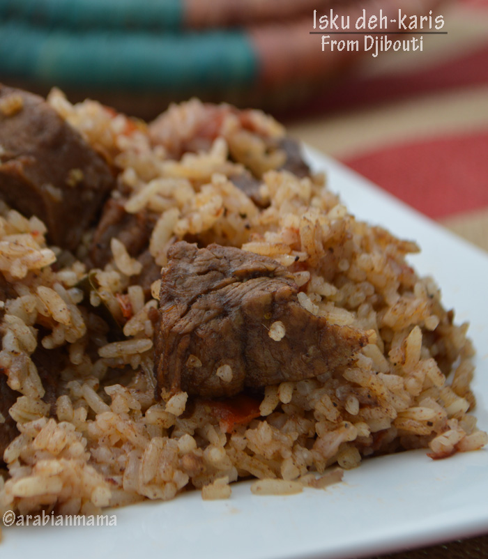 A close up of a plate of food with rice, and meat