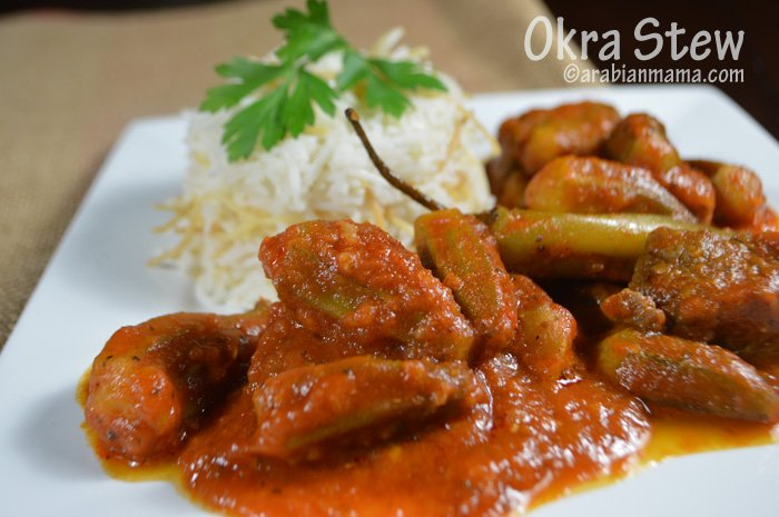 A close up of a plate of food, with white rice, and Okra