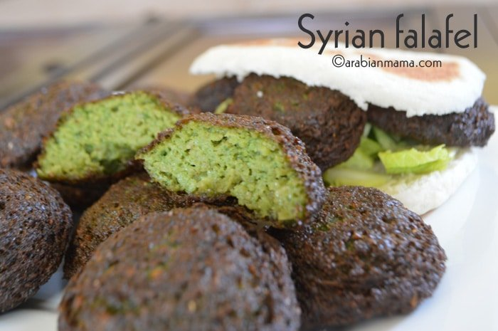 A close up of food on a plate, with Falafel