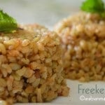 A close up of a plate of food with Freekeh