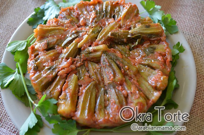 A close up of a plate of food, with Okra and Parsley
