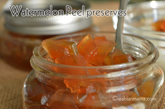A close up of a jar with watermelon jam preserves