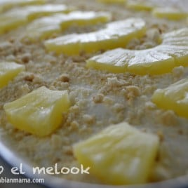 A close up of a plate of dessert with pineapples on top