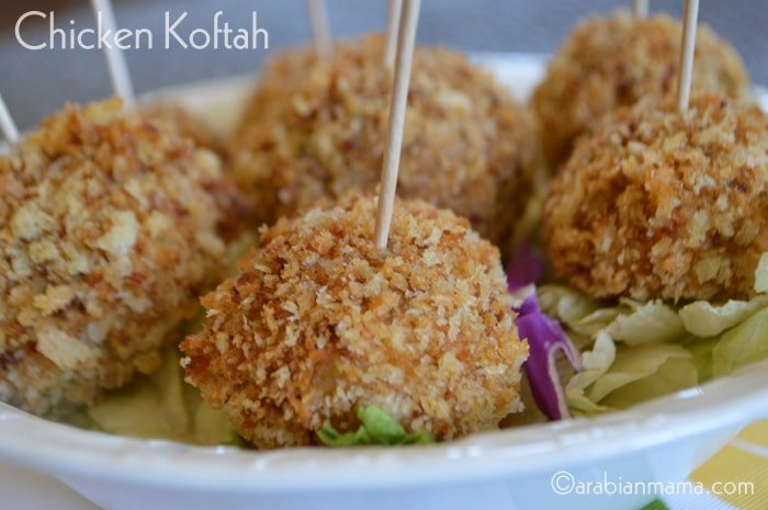 A plate full of food, with Chicken kofta balls and sticks