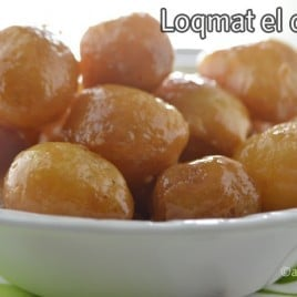 A bowl of food, with lokmat balls and syrup