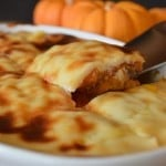 A close up of food showing a knife and pumpkin pie with bechamel on top