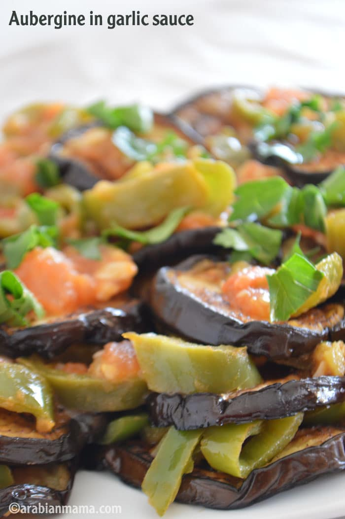 A close up of food, with garlic Aubergine and vegetables