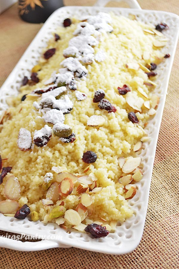 A close up of food, with Couscous and nuts