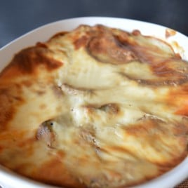 A pan showing a baked Hummus Musaka inside