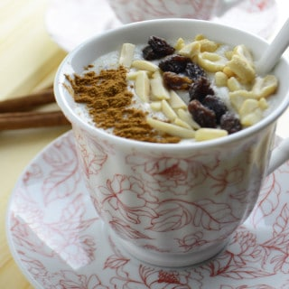 A cup of Sahlab drink with raisins and nuts
