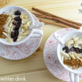 Two cups of Sahlab drink with raisins and nuts