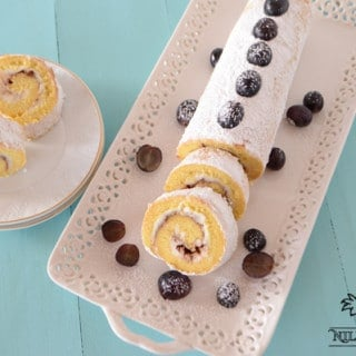 A close up of Cinnamon swiss roll slices and grapes