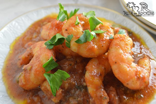 Shrimp in minty tomato sauce garnished with parsley