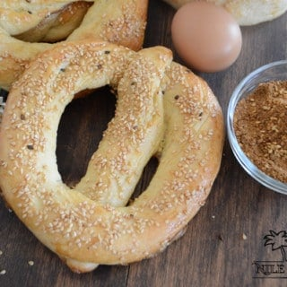 A Simit bread on a table with spices and eggs