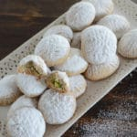 Kahk cookies on a plate, with Kahk and Pistachio
