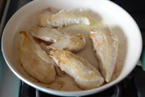A bowl of chicken meat on a table