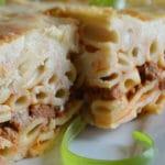 A close up of a piece of baked bechamel pasta