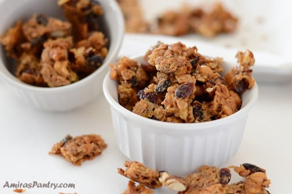 Baklava granola bites/clusters packed in a ramekin with another ramekin in the back.