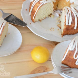 A plate with a fork and knife, with Lemon Buttermilk piece of cake