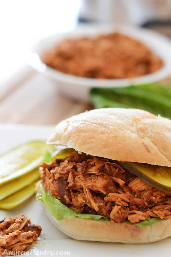 An easy and quick bbq pulled chicken sandwiches recipe for your next party, throw everything in the slow cooker and let it do its magic