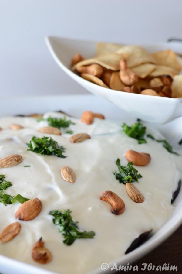 A plate of food, with Eggplant and Yogurt