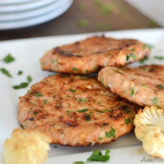 A plate of food, with Sausage patties