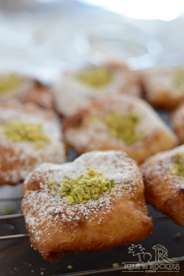 Light as a feather,crunchy as a newly fallen leaf in the fall, stuffed with delicious semolina pudding and sprinkled with icing sugar. Tamreyah is atraditional Palestinian dessert, to be specific it is a Nabulsi dessert, that is a delight to your eyes and taste buds. An Arabic dessert at its best.