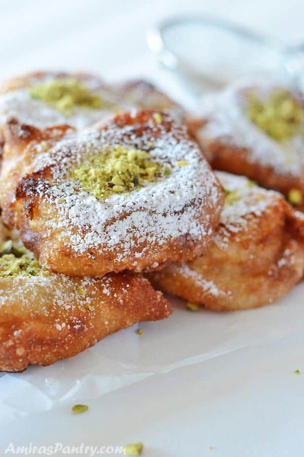 Light as a feather, crunchy as a newly fallen leaf in the fall, stuffed with delicious semolina pudding and sprinkled with icing sugar. Tamreyah is a traditional Palestinian dessert, to be specific it is a Nabulsi dessert, that is a delight to your eyes and taste buds. An Arabic dessert at its best.