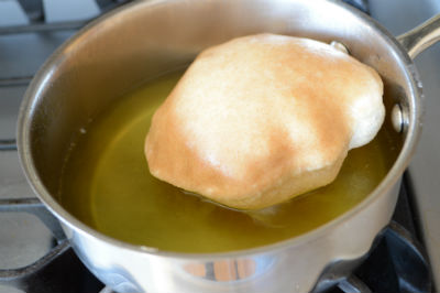 Poori is a perfectly puffed fried whole wheat bread with a golden color and a spherical shape, a feast on its own.