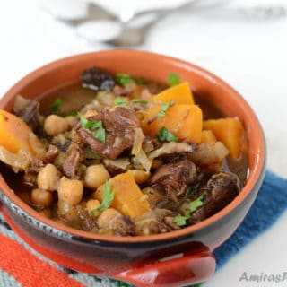A bowl of soup, with Beef and Butternut squash