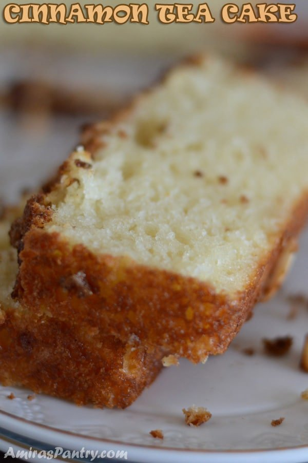 A close up of a slice of cake on a plate, with Cinnamon cake