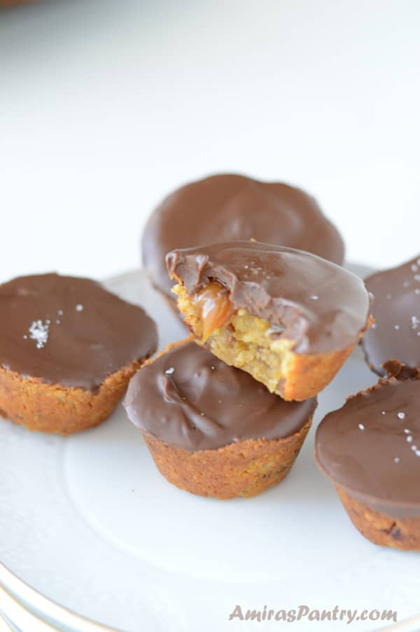 pumpkin oats caramel cups covered with chocolate in a white plate.