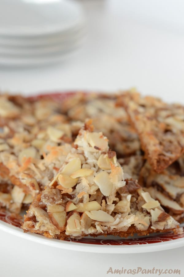 A close up of food on a plate, covered with nuts
