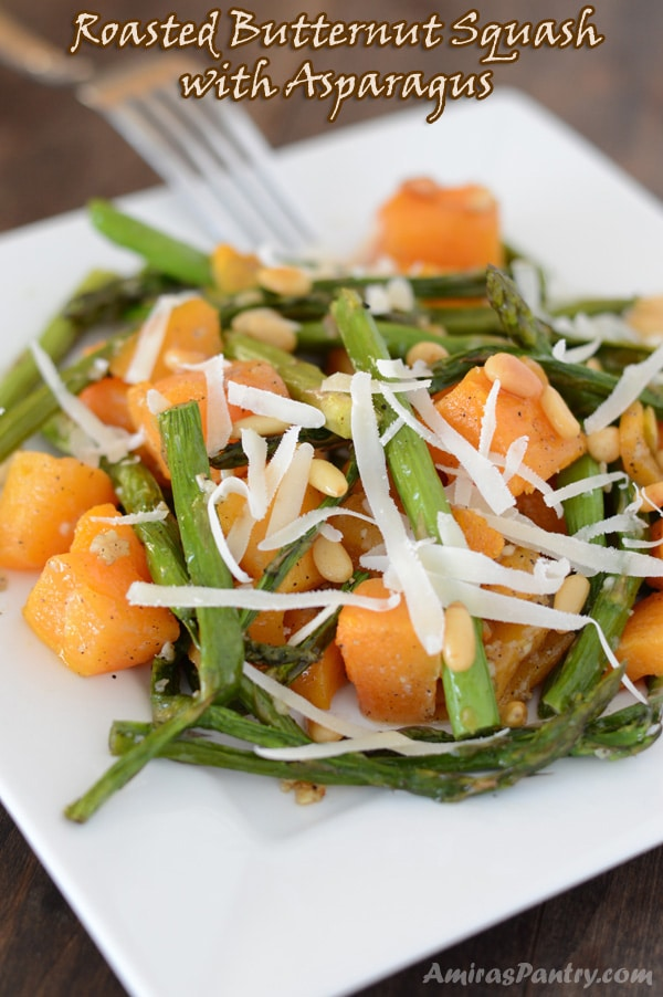 A close up of a plate of food, with butternut squash and asparagus