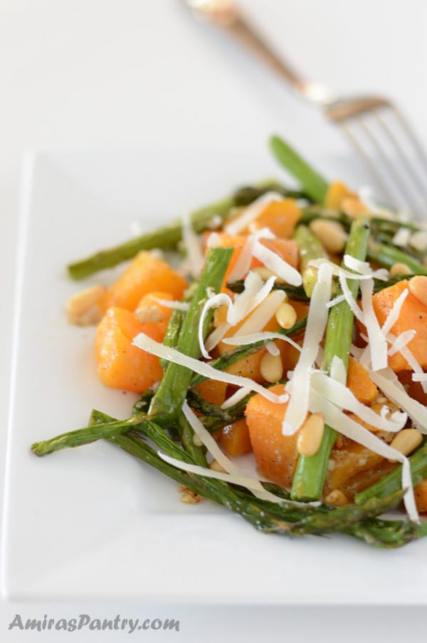 Roasted butternut squash with asparagus is a quick, easy and healthy side dish to accompany any buffet you have this holiday season.
