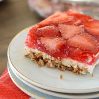 A piece of pretzel strawberry cake on a plate