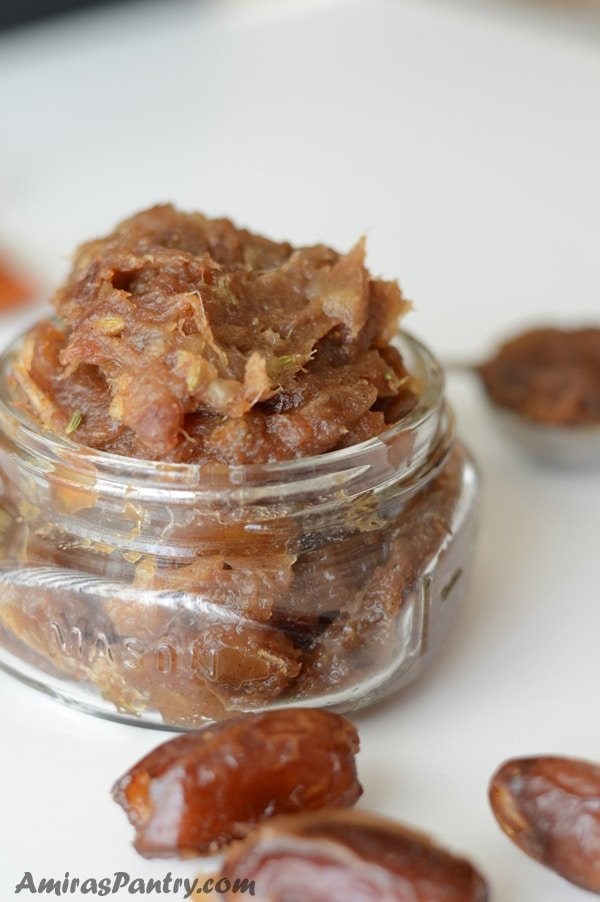 A close up of a jar with date paste