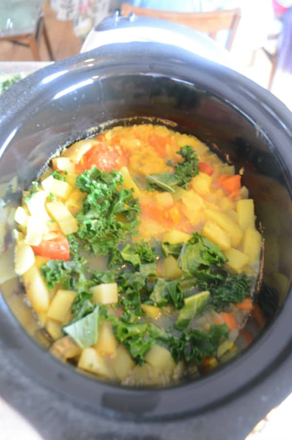 A bowl of food with vegetables