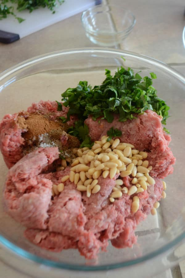 A bowl of food on a table, with ground beef and mixture